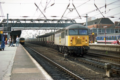56087 heads south through Doncaster at 18:25 with an empty MGR from one of the Aire Valley power stations. Withdrawn in January 2007, 56087 currently awaits its fate at Crewe DMD (info courtesy WNXX.com). (jezdgould) Tags: grid brush coal britishrail mgr doncaster railfreight class56 56087 rustonpaxman