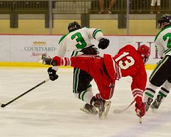 Get off my back! (R.A. Killmer) Tags: ice hockey skate skill stick puck sru slippery rock green white hit check fast
