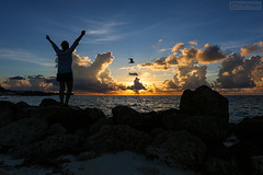 Here comes the sun - Bahamas (Nino H) Tags: bahamas freeport grand bahama island ocean sunrise colors nature rocks clouds nuages women silhouette