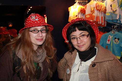 Wearing Minnie Mouse rain hats