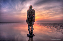 not naked anymore (gobayode photography...times) Tags: sunset seascape ironman publicart beachart antonygormley anotherplace crosbybeach sunsetseascape truthandillusion