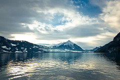 Swiss Lake (N+C Photo) Tags: travel blue trees winter vacation lake holiday snow mountains reflection history tourism nature water clouds photography switzerland design casey nikon nadia europe arte earth swiss photographers images adventure collection explore viajes artists getty thun traveling fotografia turismo vacaciones mundo cultura travelers interlaken gettyimages thunersee discover aventura tierra d300 expresin historico descubrimiento traveladventure gettyimagescom gettycollection doublyniceshot tripleniceshot mygearandme cettycollection wildernessrural