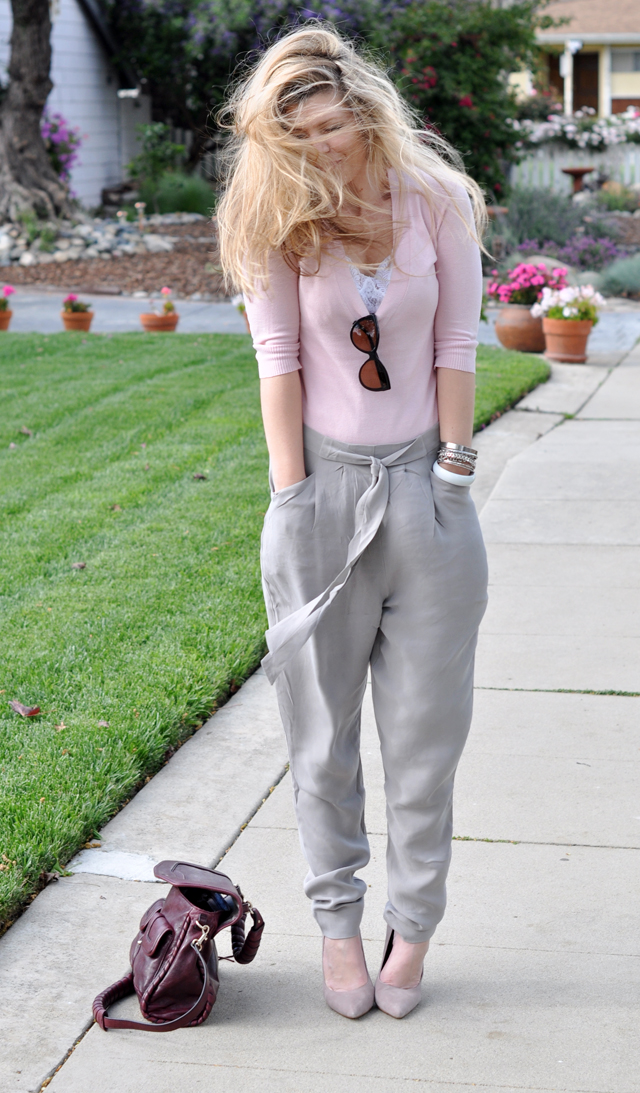 pink sweater and gray silk pants