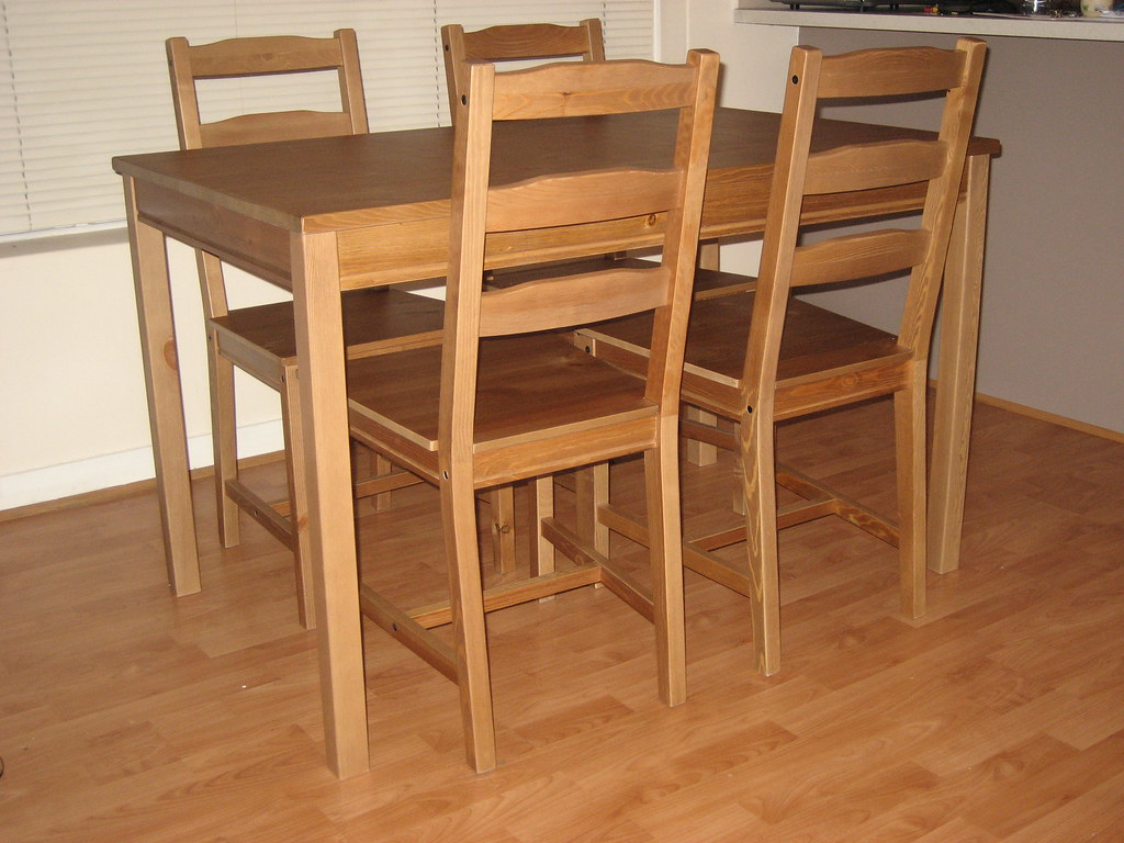 AS NEW dining table + 4 chairs $100