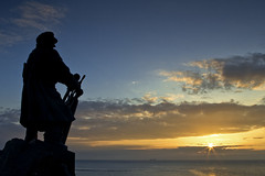 pan dorro'r wawr (i.m.j.) Tags: seascape statue wales clouds sunrise landscape dawn coast cymru wideangle lifeboat welsh rnli mr anglesey cymylau hcs ynysmn imj moelfre cerflun arfordir tirlun cymro badachub ndgrad dicevans canon7d canonef24105mm14l codiadhaul ywawr clichesaturday anglesonian dngradd ongllydan