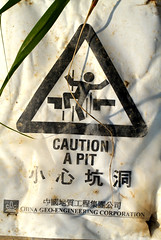 Caution A Pit (cowyeow) Tags: china old fall sign danger composition warning asian hongkong weird dangerous funny asia chinese drop pit dirty falling caution badsign funnysign funnychina funnyhongkong