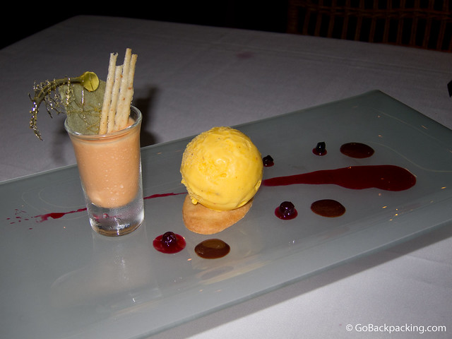 Passion fruit ice cream, tangerine mousse, and Aguardiente-flavored cookie with a strawberry coulis and touch of chocolate sauce.