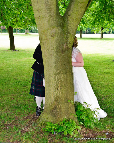 Chris and Laura snogging behind a tree