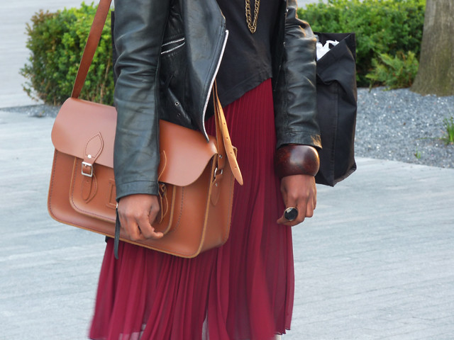 satchel red pleated skirt leather jacket