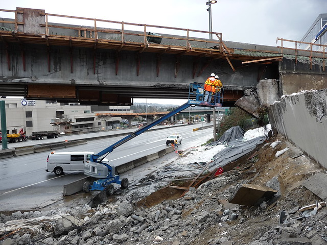 Crews inspect new NE 12th Street Bridge. The bridge was damaged during removal of the old  bridge
