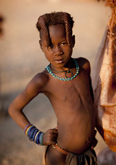 Himba Girl, Okapale Area, Namibia (Eric Lafforgue) Tags: africa people childhood vertical standing outside outdoors person one necklace kid exterior child african culture tribal safari ornament innocence afrika tribe ethnic hairstyle namibia humanbeing plaits tribo himba colorphoto afrique ethnology tribu southernafrica herder namibie 0722 lookingatcamera tribus namibe namibi namiibia ethnie ethnicgroup traditionalhairstyle     namibya namibio traditionalornament    okapale herdingpeople okapalearea