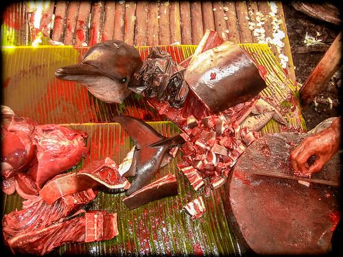 Butcher at fish market: Ende, Lombok