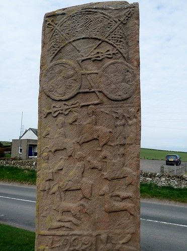 Hunting scene and abstract symbols on Pictish stone