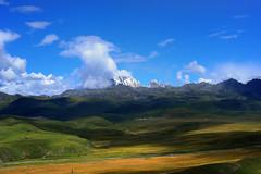 Mount Zhara Lhatse 5820m a sacred mountain in Tibet (reurinkjan) Tags: nature prayerflag chenresig drolma lungta chanadorje sacredmountains jambayang tibetanlandscape     janreurink ommanipemehung tibetanplateaubtogang kham buddhism tibet sacredmountainsoftibet dardocounty zharalhatse5820m19094ft lhaganggompa minyaglhagangyongdzograbgilhakangtongdrolsamdribling chortenmchodrten nyingmapasherda prayerflagsonstaff landscapeyulljongs naturerangbyung sunsetnyirgas 2010 lhaganglhasgang landscapesceneryrichuyulljongsrichuynjong peakofasolitarymountainridochadridoch