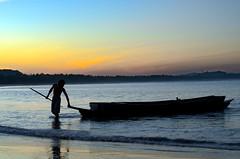 The fisherman and his boat (VespaTS) Tags: sea beach silhouette sunrise boat asia ship pentax burma myanmar pulling birma k5 smcpentaxf50mmf17 burma2010