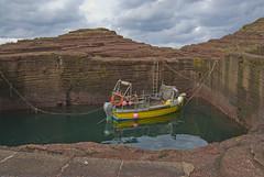A Boat (Sandy Beach Cat) Tags: uk red sea orange yellow rock scotland boat harbour lothian eastlothian tantallon auldhame