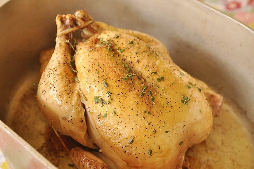 herb roasted chicken in a roasting pan