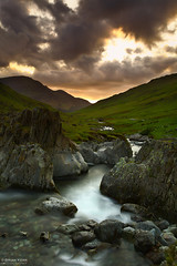 Staring At The Sun (.Brian Kerr Photography.) Tags: longexposure sunset clouds canon river landscape back nationalpark rocks stream lakes lakedistrict cumbria flowing buttermere cumbrian honister honisterpass eos5dmkii briankerrphotography