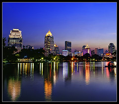 lights on at the Lumphini (PNike (Prashanth Naik..back after ages)) Tags: lake reflection thailand nikon cityscape skyscrapers bangkok citylights bluehour watercolors tallbuilding lumpinipark reflectioninwater pnike yahoo:yourpictures=skyline yahoo:yourpictures=reflections