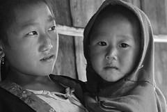 Two sisters (Noel Molony) Tags: family children rice health stories waterpumps healthcentre monvillage concernstaff educationonhealth hamkongvillage haumeuangdistrict pakhataivillage pasortvillage salongvillage salorvillage samhouay sopkhamvillage tarkaivillage thathvillage