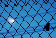 locked in (Paul is Moody) Tags: blue sky cloud fence lock bluesky locks somethingblueinmylife