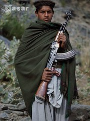 Afghan Jihad 1980 (Pashtun Afghan) Tags: portrait people afghanistan men clothing eyecontact gun serious military muslim rifle cap weapon afghan males shawl halflength machinegun guerrilla pathan headgear afghans youngadults politicalandsocialissues traditionalclothing pakhtun assaultrifle youngadultman historicevent asianhistoricalevent ak47rifle pashtun mujahideen centralasians soviethistoricalevent foreignoccupation afghanhistoricalevent sovietafghanwar19791988