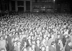 20; Crowd has gathered at ' Liberty  Corner ', corner of Featherston Street and Hunter Street - Circa 1945 (Wellington City Council) Tags: wellington historicwellington 1800s 1900s 1950s