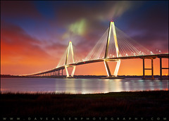 Charleston SC Arthur Ravenel Jr. Bridge Sunset (Dave Allen Photography) Tags: bridge charleston charlestonsc arthurravenelbridge daveallen 50mm patriotspoint suspensionbridge commercial photography landscape cooperriver sunset night evening clouds sky stock longexposure lighting light daveallenphotography d700 mygearandmediamond artistoftheyearlevel6 architectural architecture outdoors sc southcarolina lowcountry