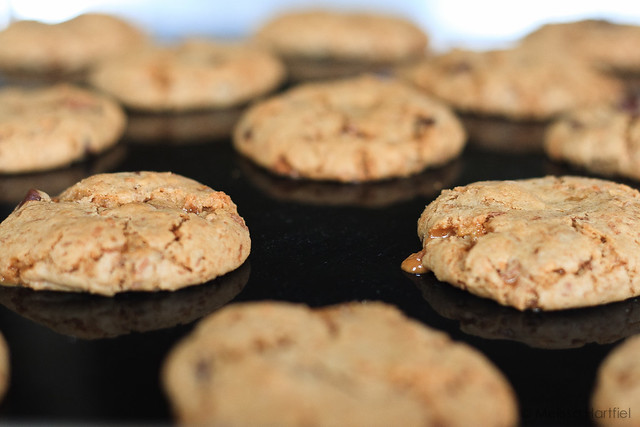 cookies on a cookie sheet with melted toffee oozing out
