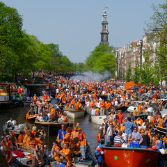 Q-day on the canals of Amsterdam (Bn) Tags: street party people music orange holiday netherlands dutch amsterdam boats canal crazy dancing boten celebration national prinsengracht loud grachten monarchy folly jordaan oranje queensday koninginnedag westertoren westerkerk wester freemarket vrijmarkt 30april qday gekkenhuis langejan dutchies orangefolly