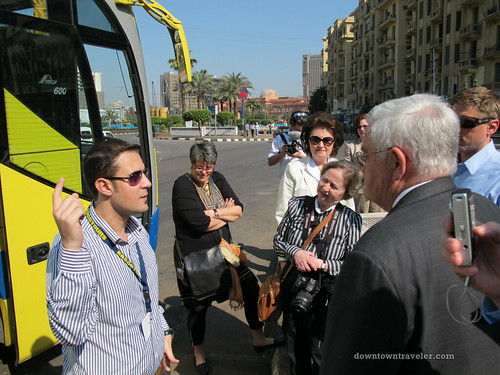The US tourism delegation listed to guide Mina Mamdouh Edwar at Tahrir Square on Sunday, April 24.