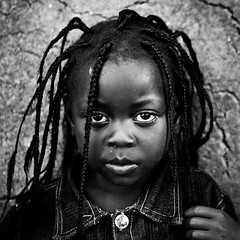 Lendu child  - DR CONGO - (C.Stramba-Badiali) Tags: africa portrait people blackandwhite girl face look person eyes child noiretblanc african human conflict blackpeople ethnic dreads hairstyle enfant fille glance rasta humanbeing humanitarian oneperson drc visage regard africain afrique lookingatme zaire displaced cheveux rdc drcongo blackchildren blackskin centralafrica ethno gety ethnie congokinshasa ituri displacedchildren peaunoire afriquecentrale lendu 5dmkii forgottenconflict christophestrambabadiali