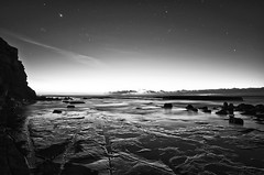 Introducing dawn.. (e0nn) Tags: ocean bw sunrise dawn mono rocks glow pentax 127 explore 50 steev bigdipper davidoliver explored barrackpoint k200d steveselbyphotography