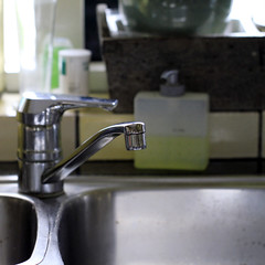 Close up of kitchen faucet and sink (!.Keesssss.!) Tags: netherlands closeup square photography day nopeople indoors hygiene domesticlife chores gettyimages royaltyfree colorimage domestickitchen focusonforeground domesticroom theflickrcollection keessmans 223ksgetty
