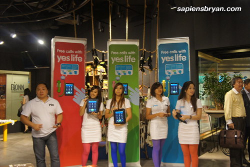 Models Showing Off Yes Life App Running On Apple iPads