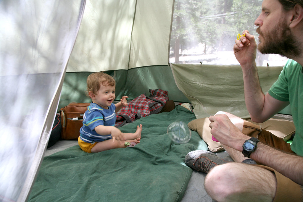 Papa and JW blowing bubbles in the tent