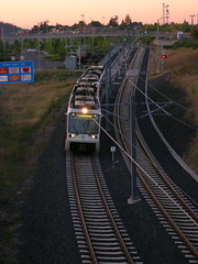 A southbound train approaches the Market St bridge