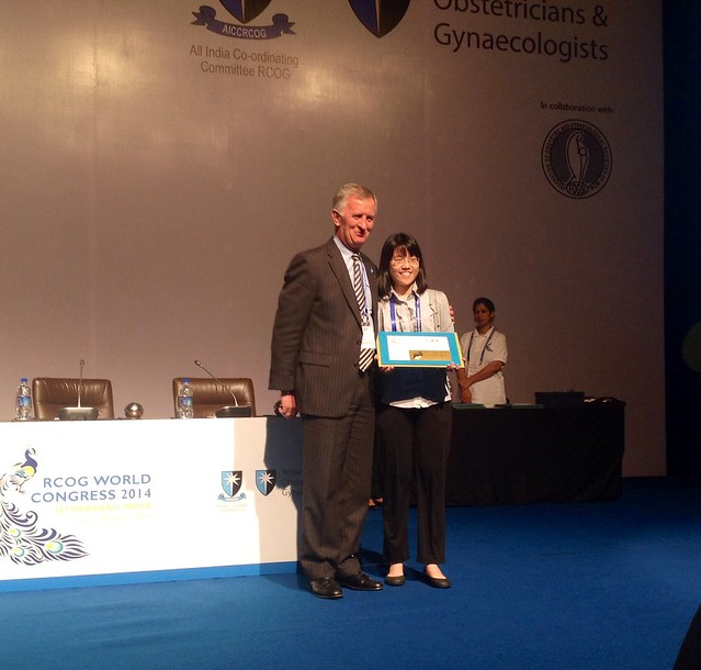 Shujing Jane Lim accepts award for her e-poster display, Hyderabad
