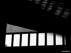 light at the top (blacqbook) Tags: light shadow blackandwhite abstract texture window glass vertical contrast shapes ceiling lookingup indoors trinidad rectangle blacqbook