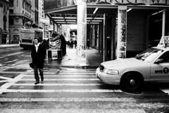 indifference (brownbeatle) Tags: street morning winter snow newyork cold yellow composition corner scarf dark crossing manhattan cab taxi streetphotography intersection subject gloom crosswalk canoncanonetql17giii kodak100tmx