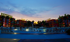 Sundown at the Pool (tim.perdue) Tags: world trip family sunset summer vacation sky beach pool animal clouds century swimming hotel orlando twilight florida kingdom disney pop resort cocoa walt 2010