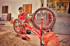 Dom Fixing His Little Brother's Bike (Captain Kimo) Tags: camera digital photoshop thailand photography highdynamicrange buriram photomatixpro hdrphotography hdrportrait singleexposurehdr hdrphotos hdrimages topazplugin