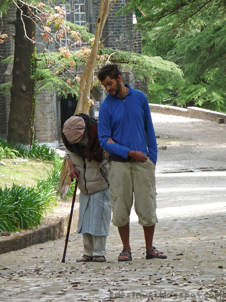 Young Man Helping Old Man