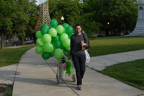Eli Pousson walking through Harlem Park on the West Baltimore Squares Spring Walk