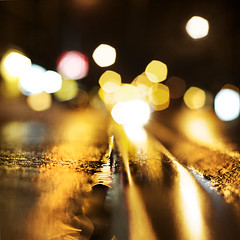 Rain Soaked Streetcar Track & The Lights Of Roncey Ave. [explored} (red_dotdesign) Tags: toronto night dark bokeh pavement tracks streetcar