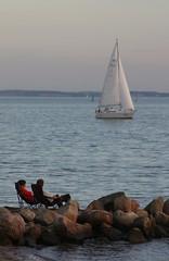 Boat watching (dididumm) Tags: people sailboat germany boot boat sitting watching balticsea sit seated ostsee segelboot schleswigholstein neustadt sailingboat
