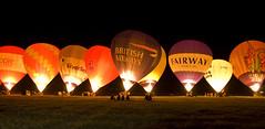 Tiverton Balloon Festival Light Show (stagenutuk) Tags: color colour night d50 balloons nikon colorful balloon nighttime devon colourful hotairballoons tivertonballoonfestival