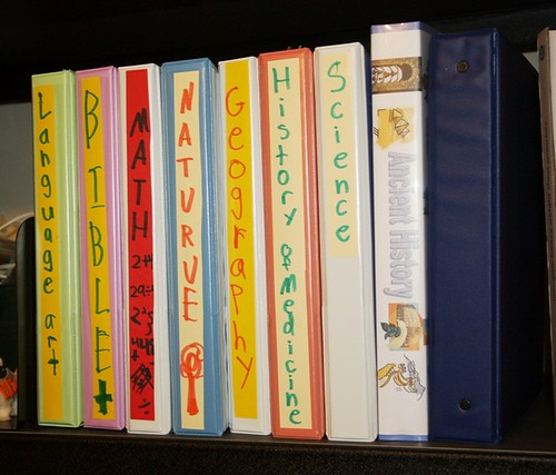 notebooks on shelf