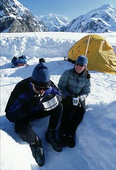 Up and About in Alaska - Matt Hage photo- Alaska climbers Mark and Amy enjoy breakfast at the Kahiltna Glacier base camp.