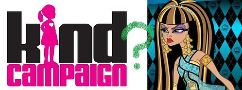 """kind campaign"" logo, first word mostly in black with the ""i"" replaced with a pink silhouette of a little girl, second word all in pink. Next to the logo, there is a glaring image of Cleo de Nile, an animated Monster High character with light brown skin, heavy purple eye makeup and long, black-brown-and-gold-striped hair."